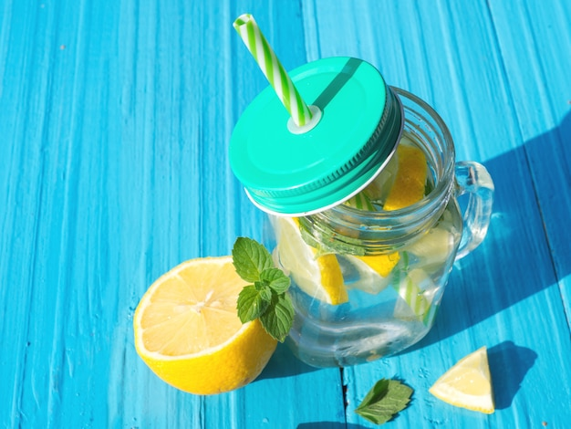 Lemonade with lemon and mint and copy space Premium Photo