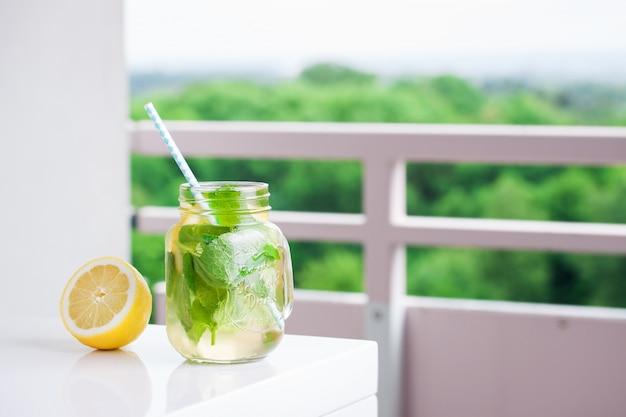 Lemonade with straw next to a lemon Free Photo
