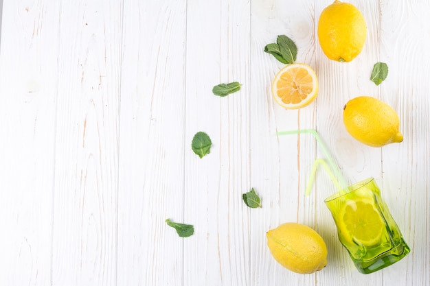Lemons and bright colored glass with straw Free Photo