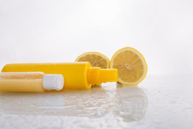 Lemons near skincare products Free Photo