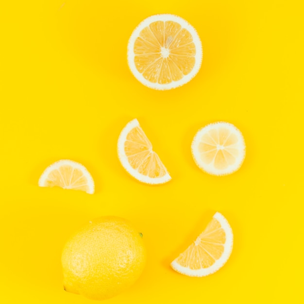 Lemons on yellow background Free Photo