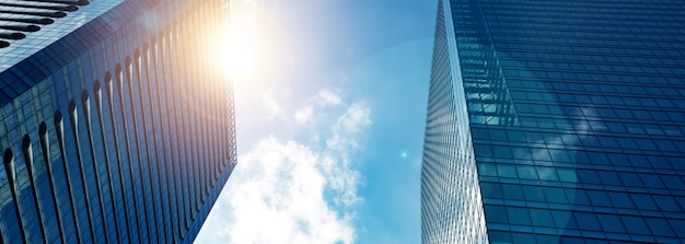 Lens flare big glass building office tower in the city. Premium Photo