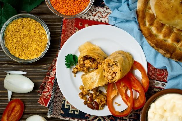 Lenten dolma or vegetable cabbage rolls - pasuts tolma is a vegetarian dish of armenian, caucasian cuisine. top view Premium Photo