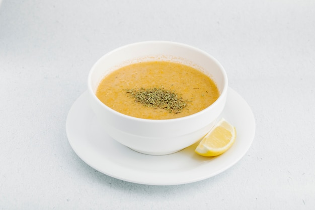 Lentil soup with herbs and spices in white bowl. Free Photo