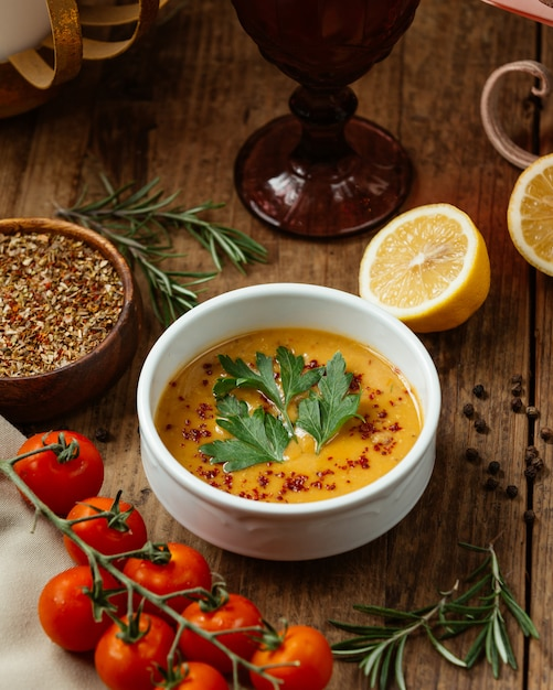 Lentil soup with spices vegetables and lemon Free Photo