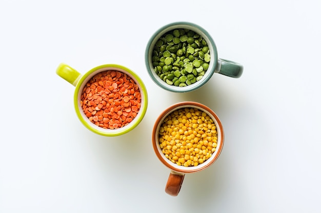 Lentils of different types and colors in portioned cups. vegan proteins. Premium Photo