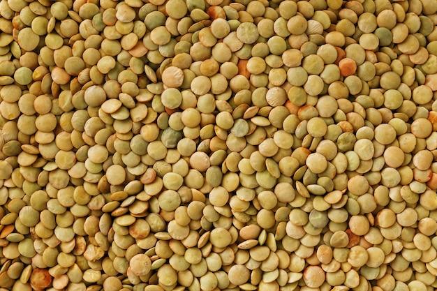 Lentils. lentils background. green lentils pattern. natural organic lentils for healthy food Premium Photo