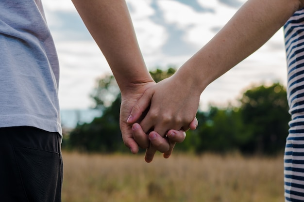 A lesbian couple holding her hands Premium Photo