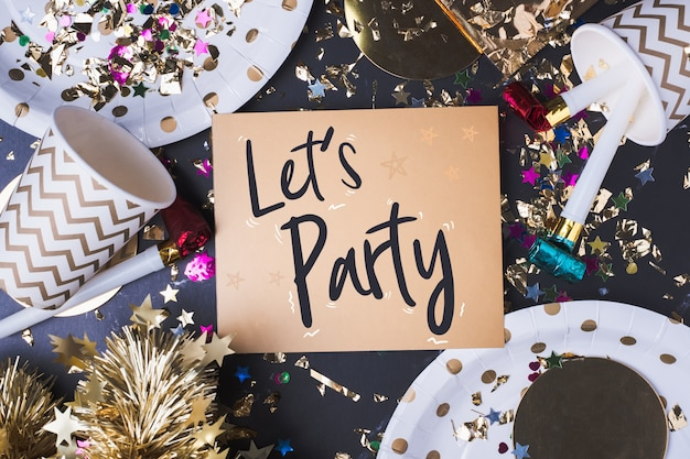 Lets party brush stroke handwriting on greeting card with party cup Premium Photo