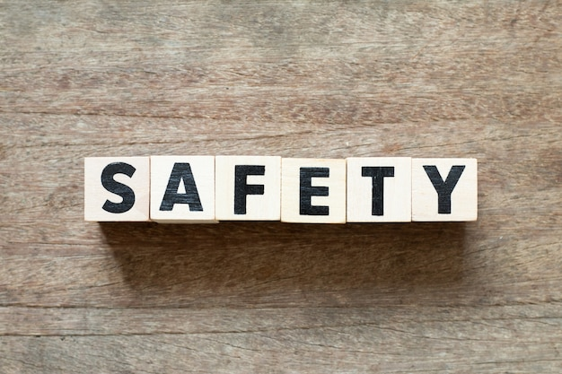 Letter block in word safety on wood background Premium Photo