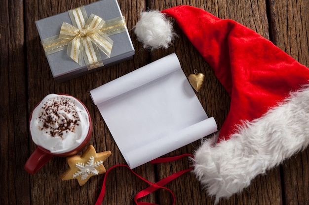 Letter to santa claus in white with a santa hat Free Photo