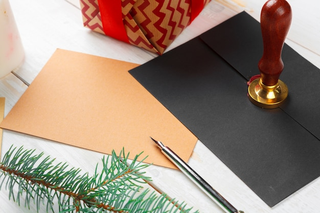 Letter to santa claus with sealing wax stamp on wooden table Premium Photo