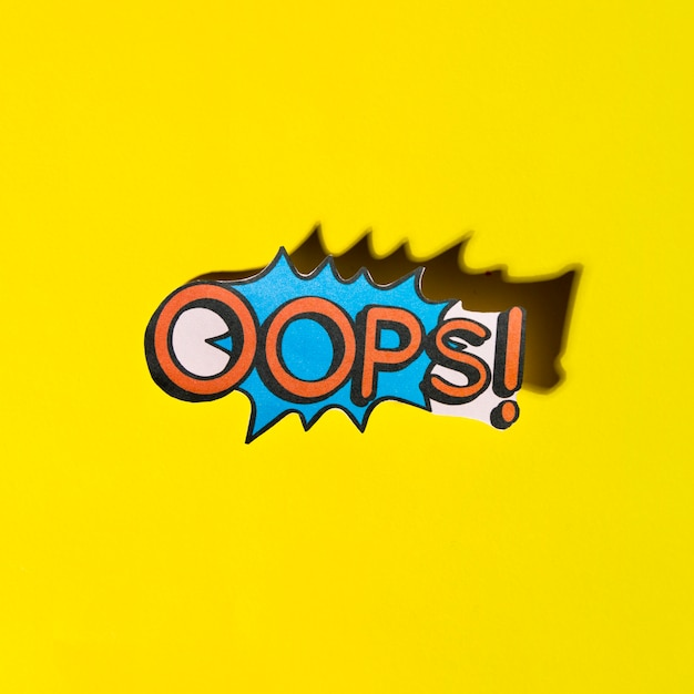 Lettering oops comic text sound effects on yellow background Photo