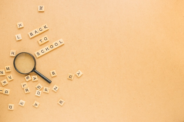 Letters around magnifying glass Free Photo