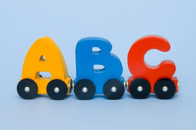 Letters a, b, c, d of a train alphabet with locomotive. Premium Photo