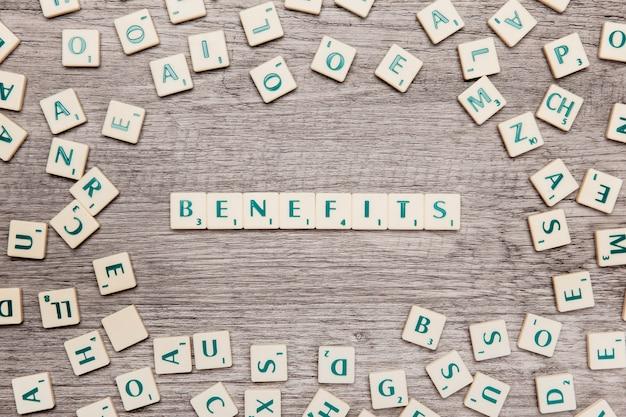 Letters forming the word benefits Free Photo