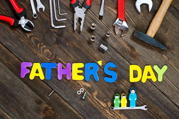 Letters and tools wooden background father's day Premium Photo