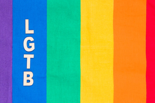 Lgbt abbreviation on blue stripe of rainbow background Free Photo