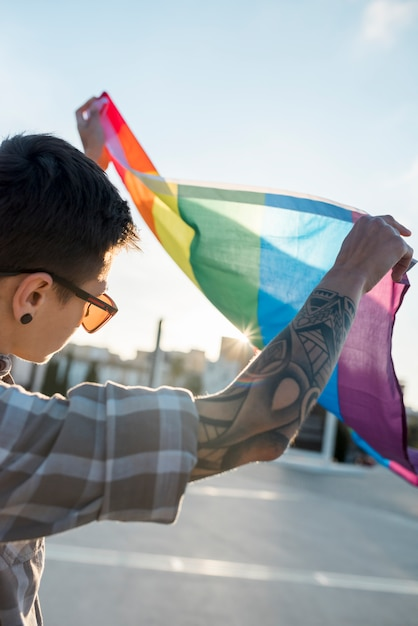 Lgbt flag in hands of person Free Photo