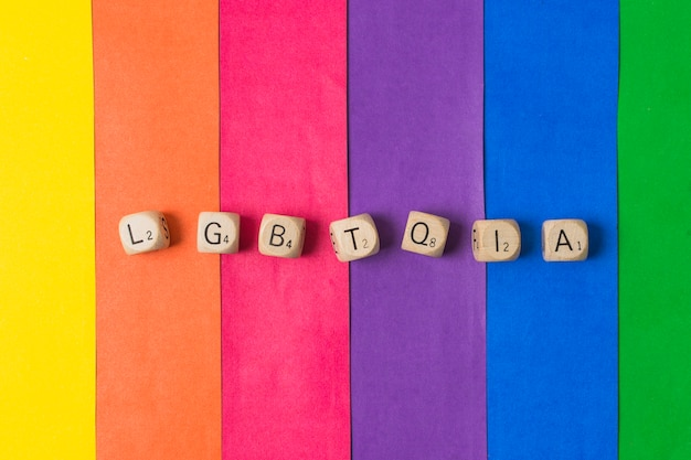 Lgbtqia word of cubes and gay flag Free Photo