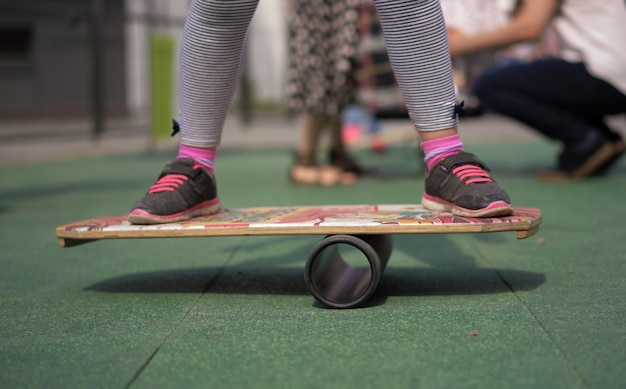 Life in a modern city - a girl rides a balance-board on an advanced playground Premium Photo