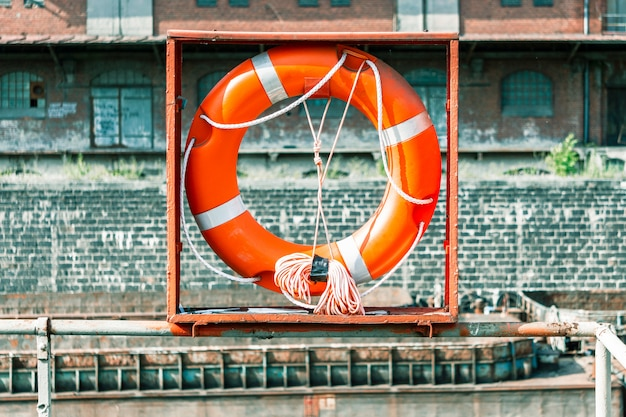Lifebuoy, against a brick wall. Premium Photo