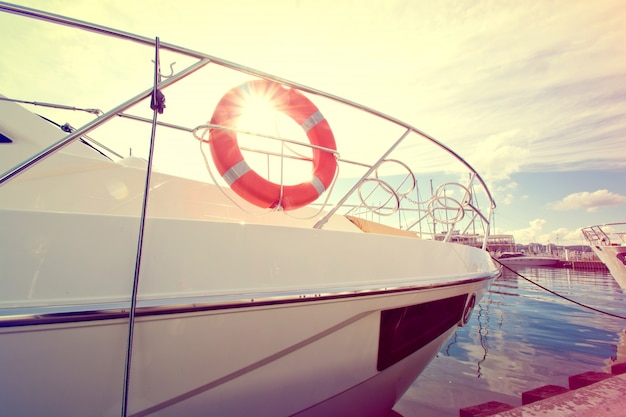 Lifebuoy on the yacht at summer day. Free Photo
