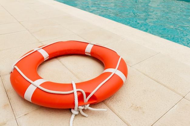 Lifeguard close to swimming pool Premium Photo