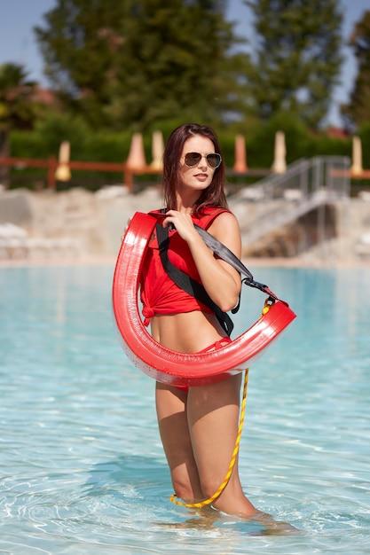 Lifeguard at swimming pool Premium Photo