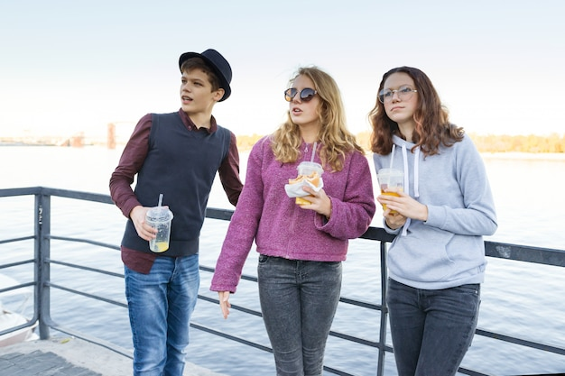 Lifestyle of adolescents, boy and two teen girls are walking Premium Photo