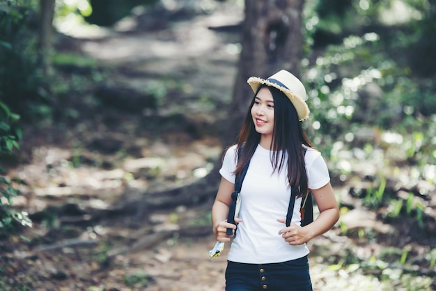 Lifestyle beautiful woman happy torist to travel in wild trip hiking during vacation. Free Photo
