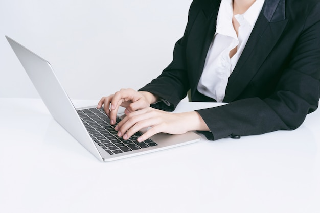 Lifestyle business people using laptop computer on office desk Free Photo