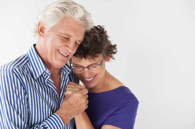 Lifestyle hugging old lover couple Free Photo