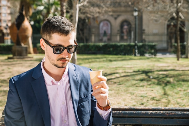 Lifestyle of modern businessman in park Free Photo