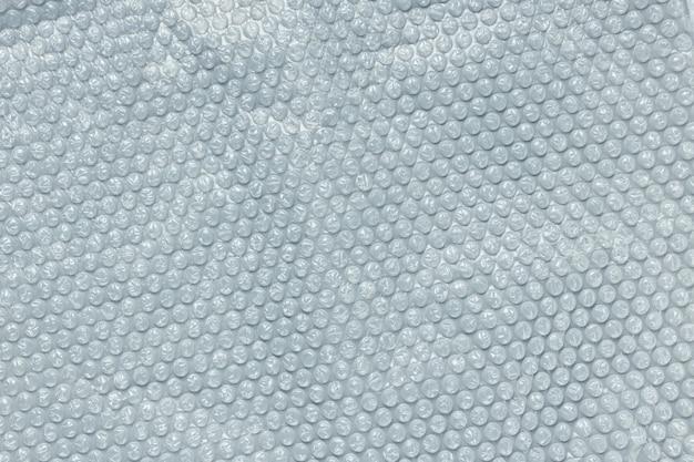 包装用の水色のバブルフォイル。クローズアップ、テクスチャ背景、汚染の概念 Premium写真