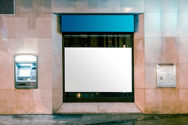 Light box display with white blank space for advertisement by street road Free Photo