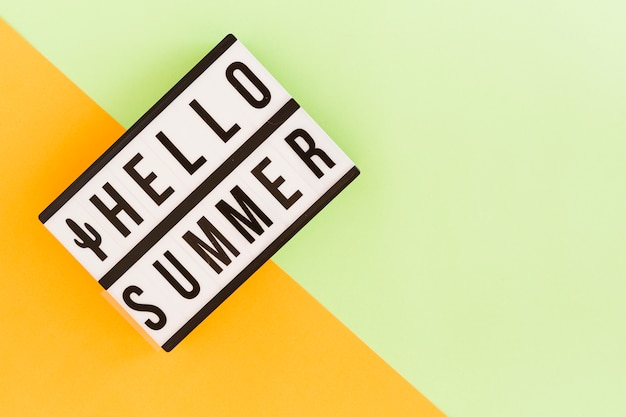 Light box with summer text on multicolored background Free Photo