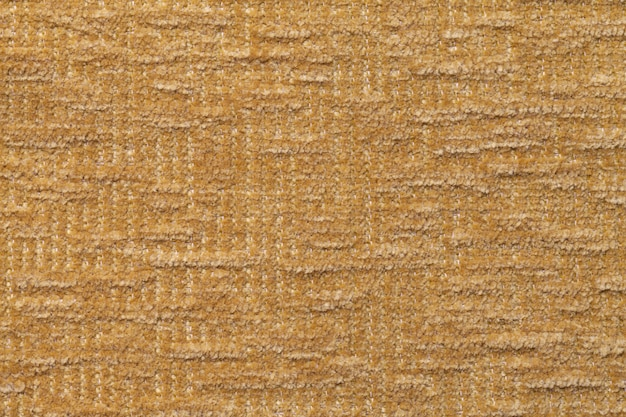 Light brown fluffy background of soft, fleecy cloth. texture of textile closeup. Premium Photo