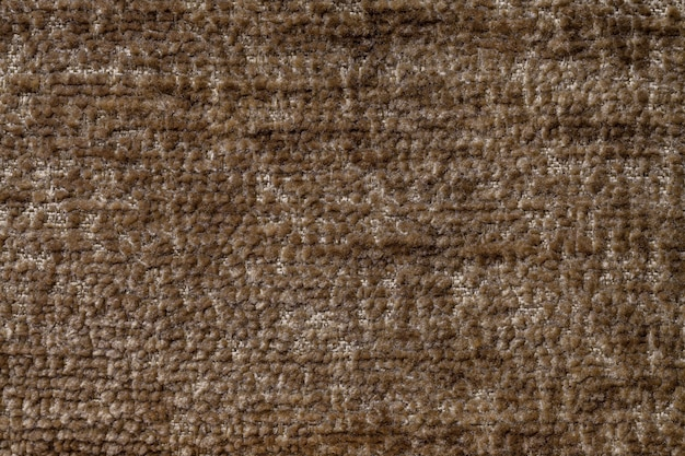 Light brown fluffy background of soft, fleecy cloth. texture of textile closeup Premium Photo