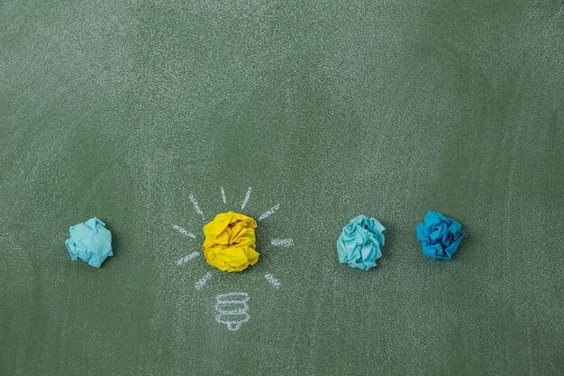 Light bulb created with crumpled paper balls Premium Photo