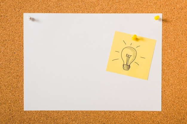 Light Bulb Drawn Icon On Yellow Sticky Note Over The