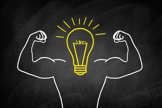Light bulb drawn in yellow with muscular arms Free Photo