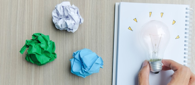 Light bulb or lamp with colorful crumpled paper Premium Photo