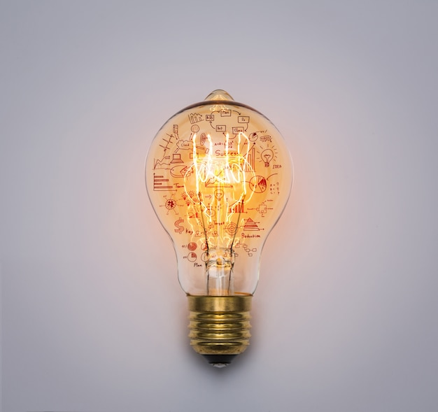Light bulb with drawing graph Free Photo