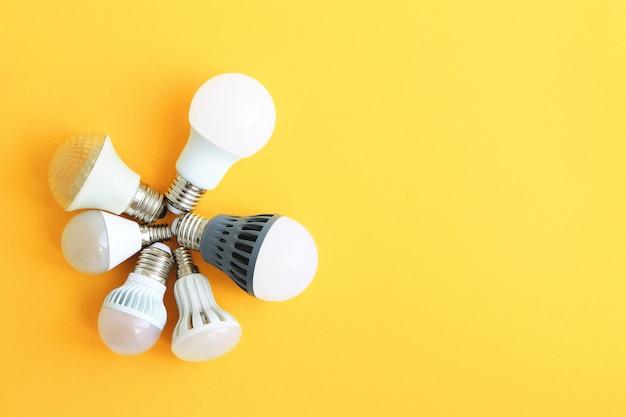 Light bulbs on a yellow background Premium Photo