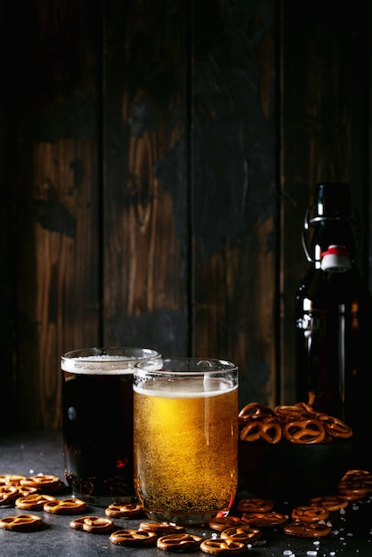 Light and dark craft beer in glass mugs Premium Photo
