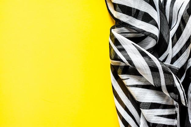 Light elegant transparent gas shawl,scarf with black and white stripes with a zebra ornament Premium Photo