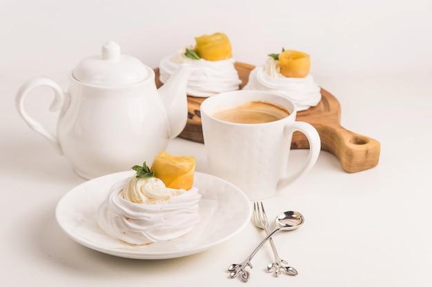 Light festive pavlova dessert made from meringue, lemon kurt and whipped cream Premium Photo