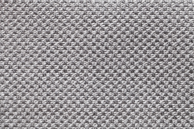 Light gray textile with checkered pattern, closeup. structure of the fabric macro. Premium Photo