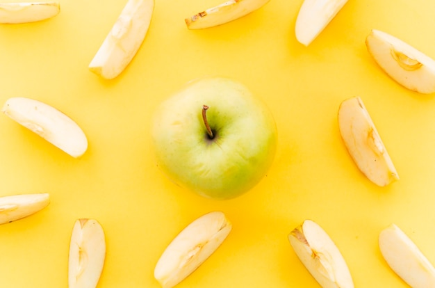 Light green apple among apple pieces Free Photo